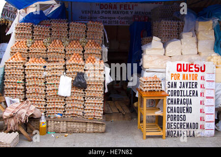 Selling many eggs and cheese on the Sucre market - Stock Image