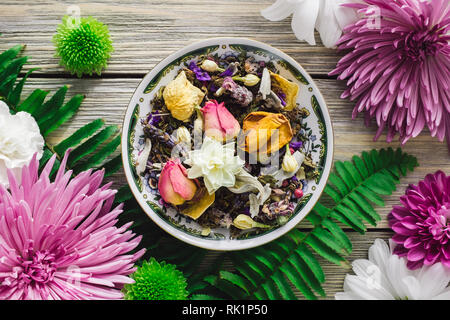 Decorative Plate with Dried Herbs, Dried Flowers and Spring Flowers - Stock Image
