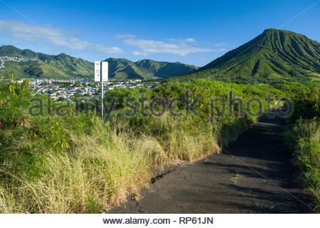 On access road that leads to the summit of Koko Head looking towards Koko Head Crater and the Honolulu suburb of Hawaii Kai, Koko Head District Park,  - Stock Image