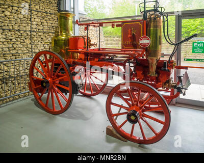 A horse drawn Fire engine for extinguishing fires built by Merryweather in 1880 for Gateshead council displayed at NRM Shildon - Stock Image