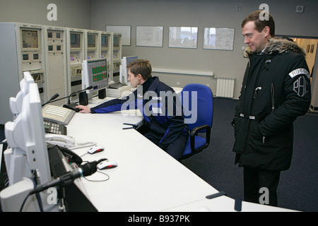 First Deputy Prime Minister Dmitry Medvedev right beside the control panel of the Volokolamskaya compressor plant - Stock Image