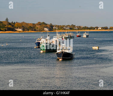 Bright colorful wooden boats cabin cruisers in Chatham Harbor, Chatham, Cape Cod, Massachusetts, October 2015. - Stock Image