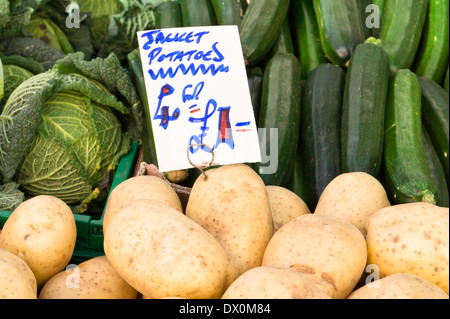 Fresh vegetables for sale at a market stall in the UK - Stock Image