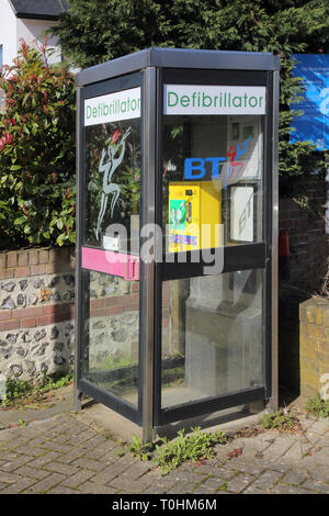 defibrillator in an old telephone box in the small sussex village of bramber west sussex - Stock Image