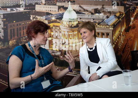 First Minister Nicola Sturgeon (right) with senior lecturer Maria Economou from Greece during a visit to Tay House, Glasgow, where she met with EU nationals working at the University of Glasgow ahead of next week???s European election. - Stock Image