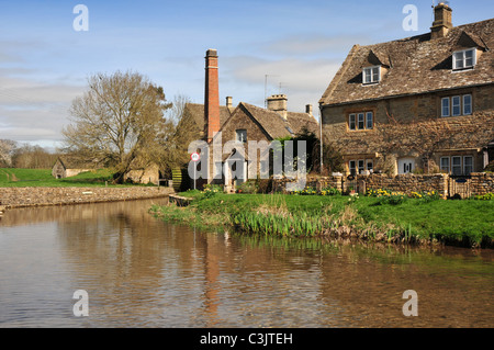The Old Mill Museum beside the River Eye, Lower Slaughter, Gloucestershire - Stock Image