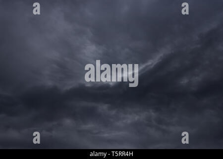 cloudscape background with dark stormy clouds - Stock Image