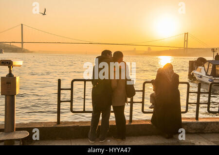 View of the Bosphorus at sunset from the Asian side.  The first Bosphorus bridge can be seen in the background, - Stock Image