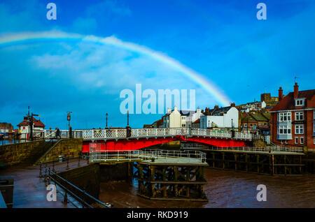 A raindow in winter sunlight over Whitby swing bridge - Stock Image