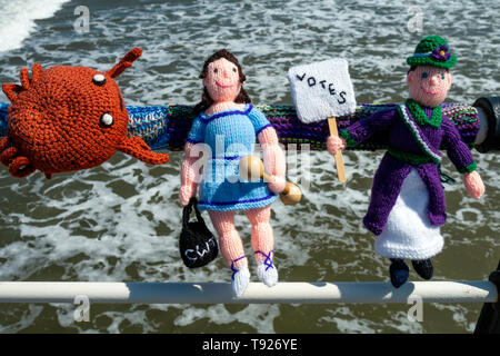 Yarn Bombing decorating public place with knitted objects here a voter for the Brexit Party for MEP election 23 May 2019 Saltburn Pier handrail - Stock Image