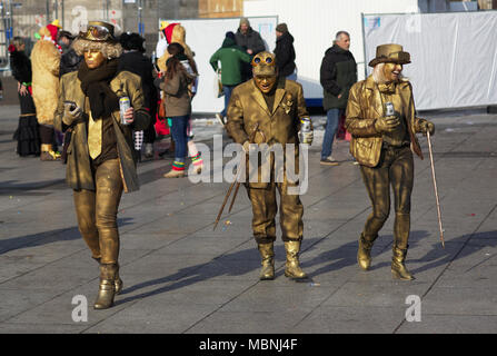 People dressed up in golden carnival costumes - Stock Image