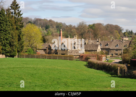 View of Lower Slaughter, Gloucestershire showing chimney of The Old Mill Museum - Stock Image
