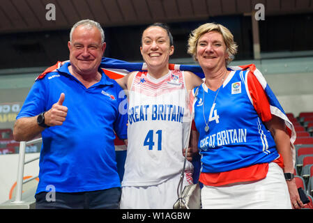 Riga, Latvia. 1st of July, 2019. Eilidh Simpson (C), with her parents Great Britain's Women's basketball team celebrates win against Montenegro, during qualification match to 1/4 final at  FIBA Women's Eurobasket 2019 in Riga , Latvia. Credit: Gints Ivuskans/Alamy Live News - Stock Image