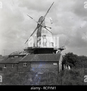 1960s, Gopsall Pottery and windmill, England, UK - Stock Image
