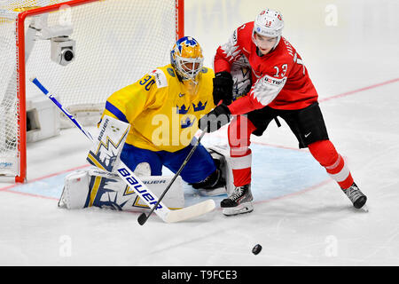 Bratislava, Slovakia. 18th May, 2019. From left hockey player of Sweden goalie HENRIK LUNDQVIST and NICO HISCHIER of Switzerland in action during the match Sweden against Switzerland within the 2019 IIHF World Championship in Bratislava, Slovakia, on May 18, 2019. Credit: Vit Simanek/CTK Photo/Alamy Live News - Stock Image
