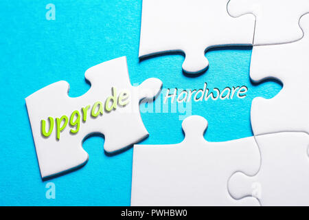 The Words Upgrade And Hardware In Missing Piece Jigsaw Puzzle - Stock Image