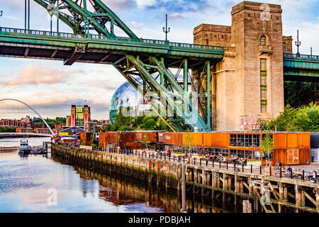 Riverside Brew Co bar and restaurant in reused shipping containers on the Tyne riverside under the Tyne Bridge, helping to regenerate Gateshead. 2018. - Stock Image