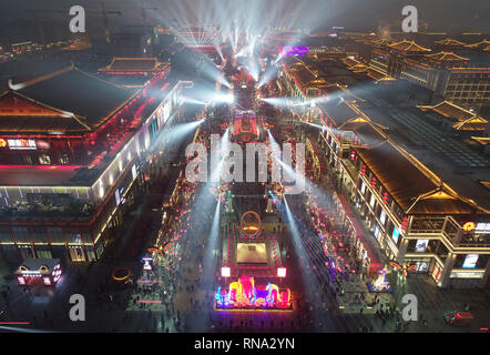 Xi'an. 17th Feb, 2019. Aerial photo taken on Feb. 17, 2019 shows a pedestrianized shopping street in Qujiang New District, Xi'an, northwest China's Shaanxi Province. Xi'an sees a boom in its tourism market as the Spring Festival holiday draws to an end, with some tourist areas still crowded with visitors. Credit: Shao Rui/Xinhua/Alamy Live News - Stock Image