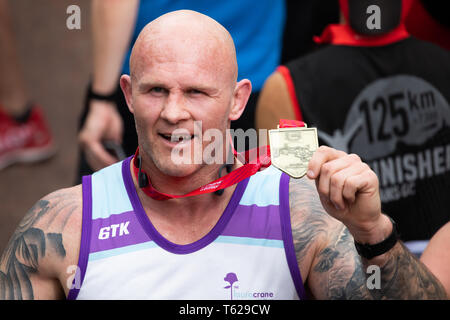 London, UK. 28th April 2019. Keith Senior, English former rugby player with his medal after completing The 39th London Marathon. Credit: Keith Larby/Alamy Live News - Stock Image