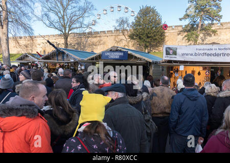 Crowd of people within LIncoln castle at Lincoln Christmas Market, Lincolnshire, England, UK - Stock Image