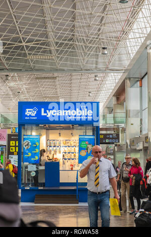 Lycamobile mobile phone kiosk in the arrivals area in Tenerife south airport selling SIM cards and roaming deals to holidaymakers as thet arrive, Cana - Stock Image
