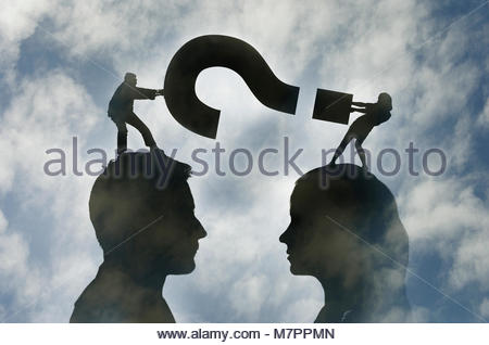 Man and woman face to face fighting over question mark - Stock Image