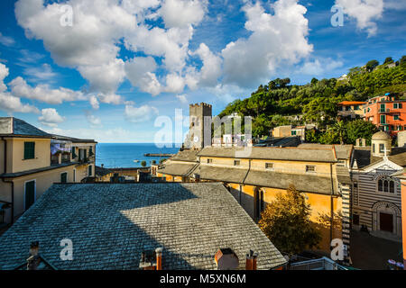The blue Ligurian sea and coast from the town of Monterosso al Mare, on the Italian Riviera of Cinque Terre Italy - Stock Image