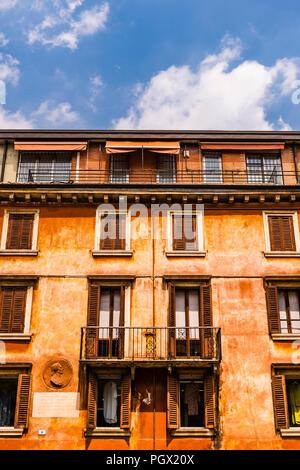 Bright orange render to building facade in Verona, Italy - Stock Image