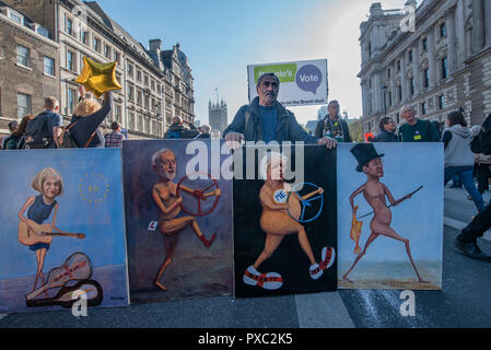 London, UK. 20th October 2018. Political artist Kaya Mar displays his portrains of Thresa May, Jerermy Corby, Boris Johnson and Jacob Rees Mogg  as marchers come down Whitehall at the end of the People's Vote March calling for a vote to give the final say on the Brexit deal or failure to get a deal. They say the new evidence which has come out since the referendum makes it essential to get a new mandate from the people to leave the EU. With so many on the march the crowding meant many failed to reach Parliament Square and came to a halt in Whitehall. Peter Marshall/Alamy Live News - Stock Image