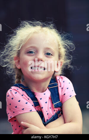 Little girl smiling with first missing tooth - Stock Image
