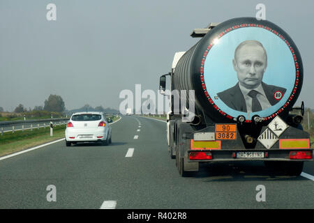 A large tank truck (Serbian licence plate) with image of Vladimir Putin on its rear, drives along the high way through Croatia. - Stock Image