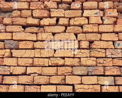 Rough not plastered bricks wall of an obsolete building - Stock Image