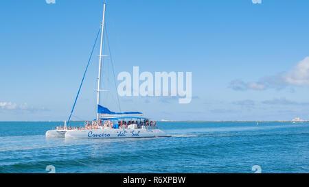 Group of tourists enjoy a tour on a large catamaran off the coast of Varadero Cuba - Stock Image