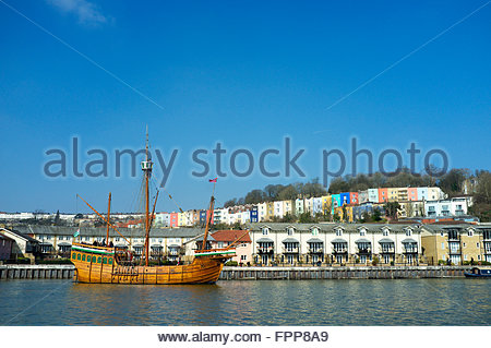 Colourful housing in Hotwells provides a backdrop to the replica ship the Matthew. Bristol Floating Harbour, UK. - Stock Image
