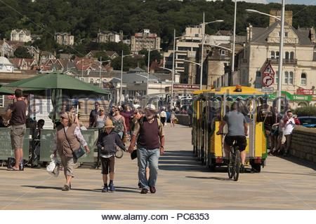 Weston-super-Mare, Somerset. 31st July 2018. UK Weather: The warm weather returns making for a promenade busy with tourists at Weston-s-Mare, Somerset, U.K. Credit: Stephen Hyde/Alamy Live News - Stock Image