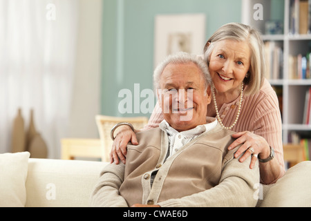 Senior woman with hands on mans shoulders - Stock Image