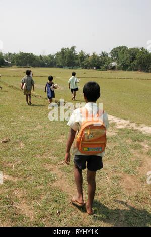 BANGLADESH 11-year-old Homar Ritchil walking to his primary school, Garo tribal minority Haluaghat, Mymensingh region photo by Sean Sprague - Stock Image