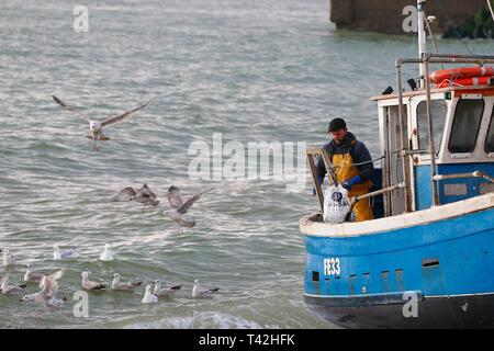 Hastings, East Sussex, UK. 13 Apr, 2019. UK Weather: Bright and cold morning in Hastings, East Sussex. The fishermen that left at 5 o'clock this morning have returned to shore with the catch of the day, Hastings has the largest beach launched fishing fleet in the UK. © Paul Lawrenson 2019, Photo Credit: Paul Lawrenson/Alamy Live News - Stock Image