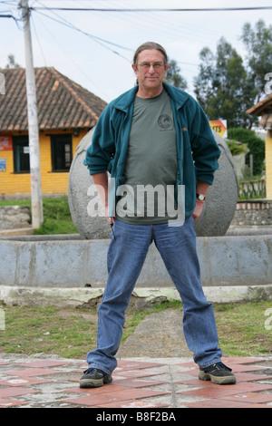 Man Standing Across the Equator Line at the Solar Culture Museum Near Quito, Equador, South America - Stock Image