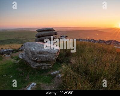 The view towards the setting sun from the stones of the Cheesewring on Bodmin Moor in Cornwall - Stock Image