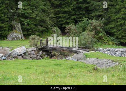 Bridge over creek - Stock Image