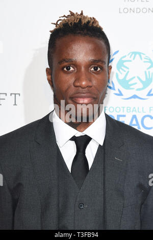 London, UK. 08th Apr, 2019. LONDON, UK. April 08, 2019: Wilfred Zaha arriving for the Football for Peace initiative dinner by Global Gift Foundation at the Corinthia Hotel, London. Picture: Steve Vas/Featureflash Credit: Paul Smith/Alamy Live News - Stock Image