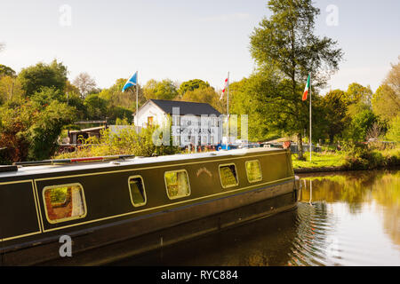 A canal barge passing the Chirk Marina on the Llangollen canal in North Wales - Stock Image