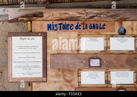 A board with game rules at Le Village Gaulois, Cotes d'Armor, Brittany, France, Europe. - Stock Image