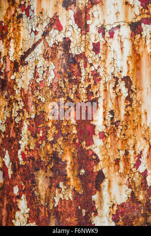 Closeup of rusty painted metal surface - Stock Image