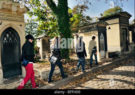 Paris, France - Female Teens Walking in Pere Lachaise Cemetery, 'French Monuments' - Stock Image