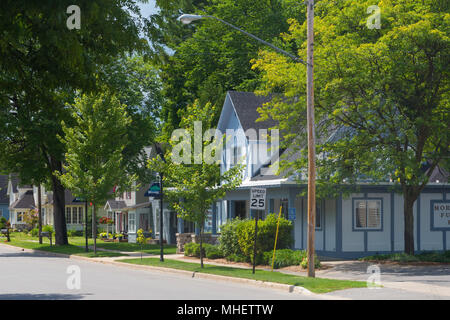 A row of houses on a suburban street in the village of Bellaire in Michigan, United States. - Stock Image