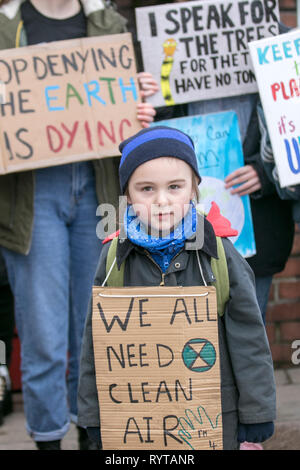 Preston, Lancashire. 15th March, 2019. School strike 4 Climate change as parents and school children assemble outside the railway station. People with banners and placards protesting for 4 action  against climate change.  The demonstrators marched through the city centre to continue their protest at the Flag Market. Children from around Lancashire having walked out of classes today as part of an international Climate Strike. Credit:MWI/AlamyLiveNews - Stock Image