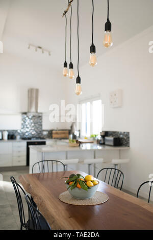Modern kitchen with wooden table - Stock Image