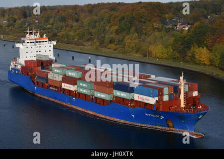 Containerfeeder Wybelsum eastbound in the Kiel Canal - Stock Image